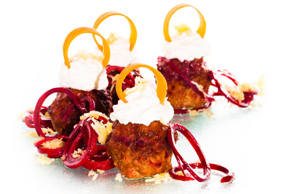 Beet root and beef patties with horseradish cream served on a beetroot salad