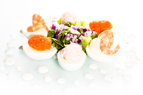 Filled egg halves with bleak roe, smoked shrimp and salmon mousse