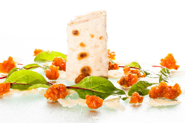 Soft flat bread rolled with Västerbotten cheese and cloudberry jam