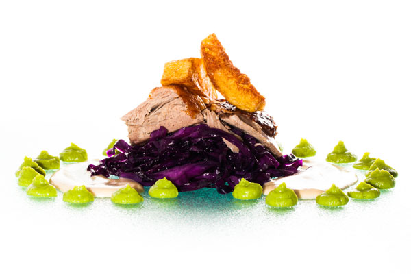 Roasted goose with red cabbage and deep fried potato wedges