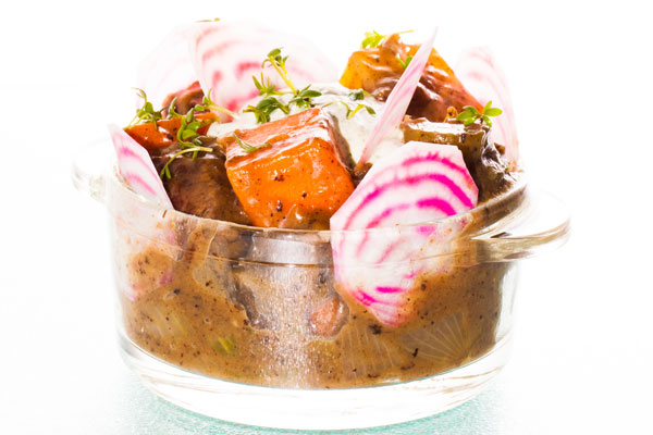 Beef stew with carrots, onions and potatoes served with parsley flavoured creme fraiche and raw polka beets