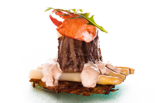 Fillet of veal with choron sauce served with a lobster claw and white asparagus
