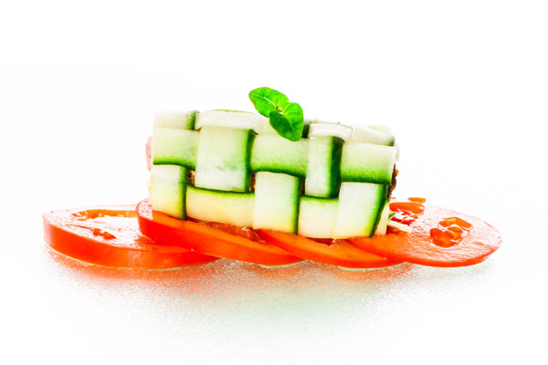 Beef roulades with tomato, cheese and basil served in cucumber
